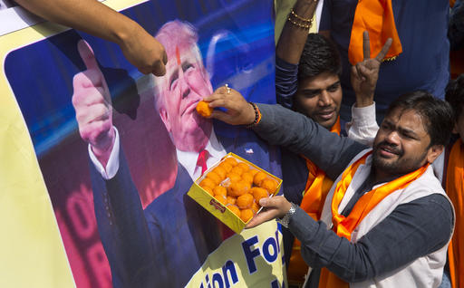 Activists belonging to 'Hindu Sena' or Hindu Army, offer sweets symbolically to presidential candidate Donald Trump's poster in New Delhi, India