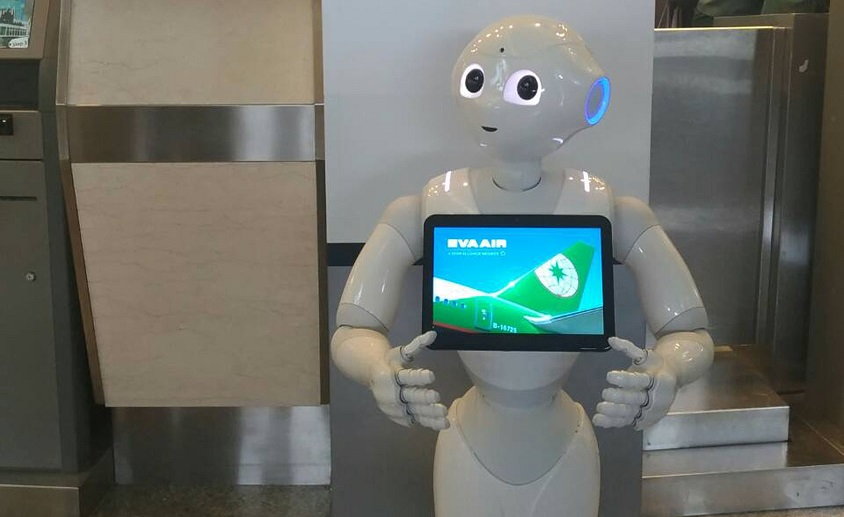 Pepper robot at Eva Airlines ticket counter at Taipei Songshan Airport.