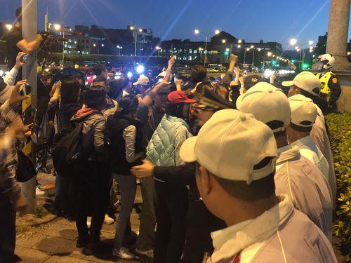 Members of Taijimen Qigong Academy swarm around Presidential Office.