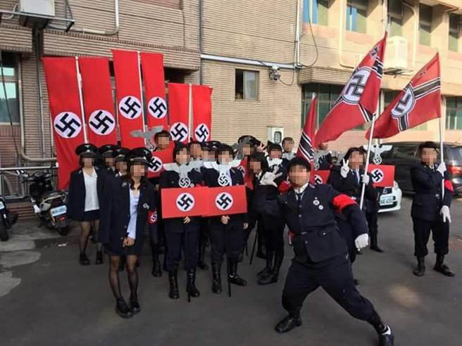 Image of students appearing to wear costumes resembling Nazi uniforms posted by Facebook user Pixar Lu