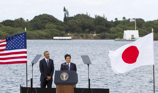 Wreaths and hugs: Japan's Abe shows sympathy at Pearl Harbor
