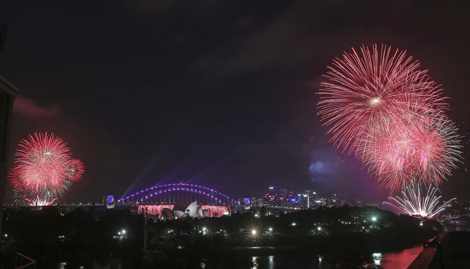 Fireworks explode around the Sydney Opera House and Harbour Bridge as New Year's celebrations get underway in Sydney, Australia, Saturday, Dec. 31, 20...