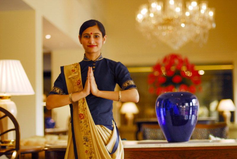 An Oberoi Hotel employee making Namaste gesture (Wikimedia Commons)