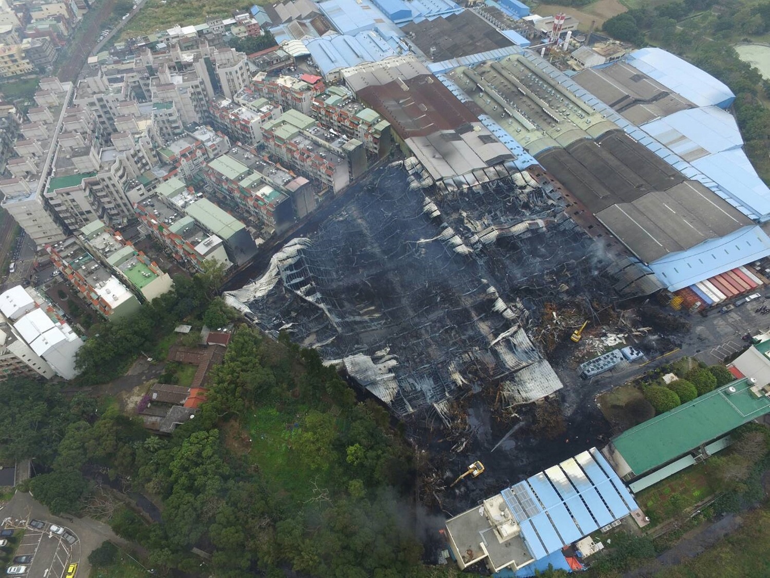 Aerial view of charred remains of tire plant