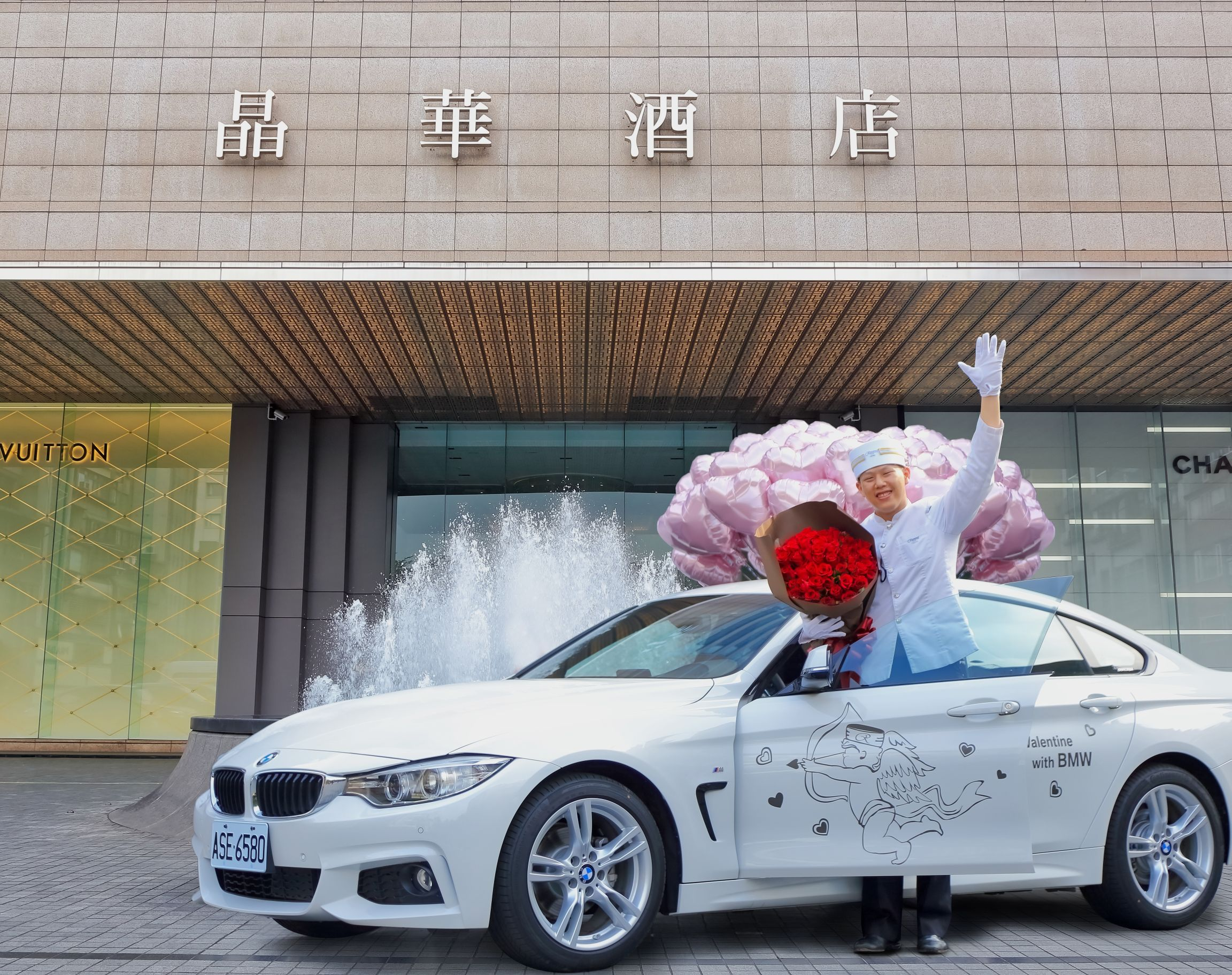 Regent Hotel staff carrying bouquet of roses climbs out of BMW Gran4Coupe.