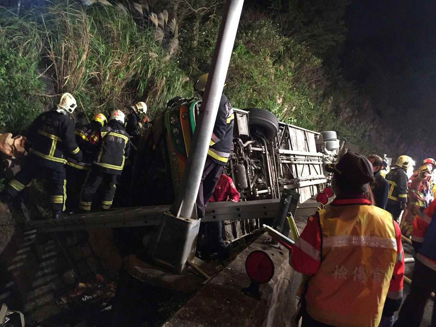 Dozens dead as Taiwan tour bus flips over near Taipei