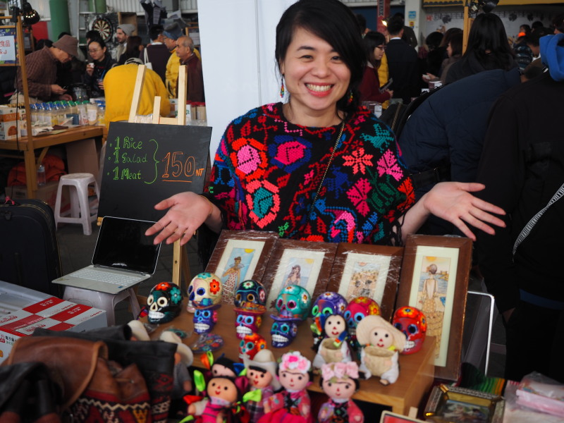Taiwanese vendor selling Mexican and Spanish handicrafts