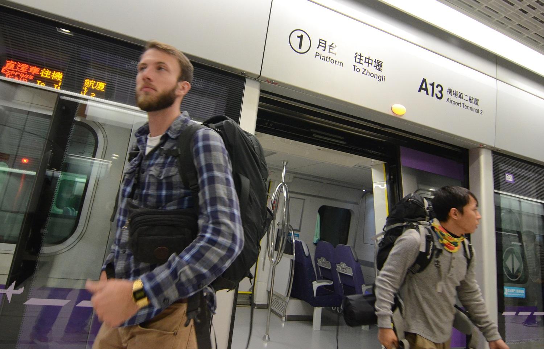Passengers disembark from new Airport MRT train