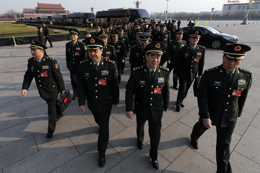 Delegates from China's People's Liberation Army (PLA) arrive at the Great Hall of the People to attend a plenary session of the National People's Cong...