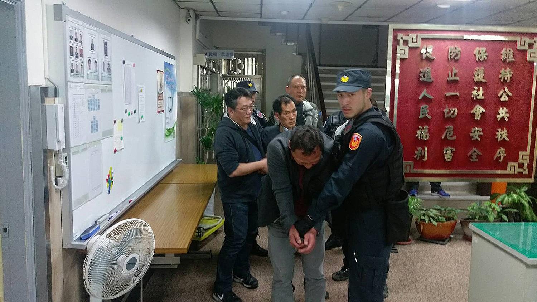 South Korean suspected of pickpocketing is taken into custody near Taipei 101 on Saturday.