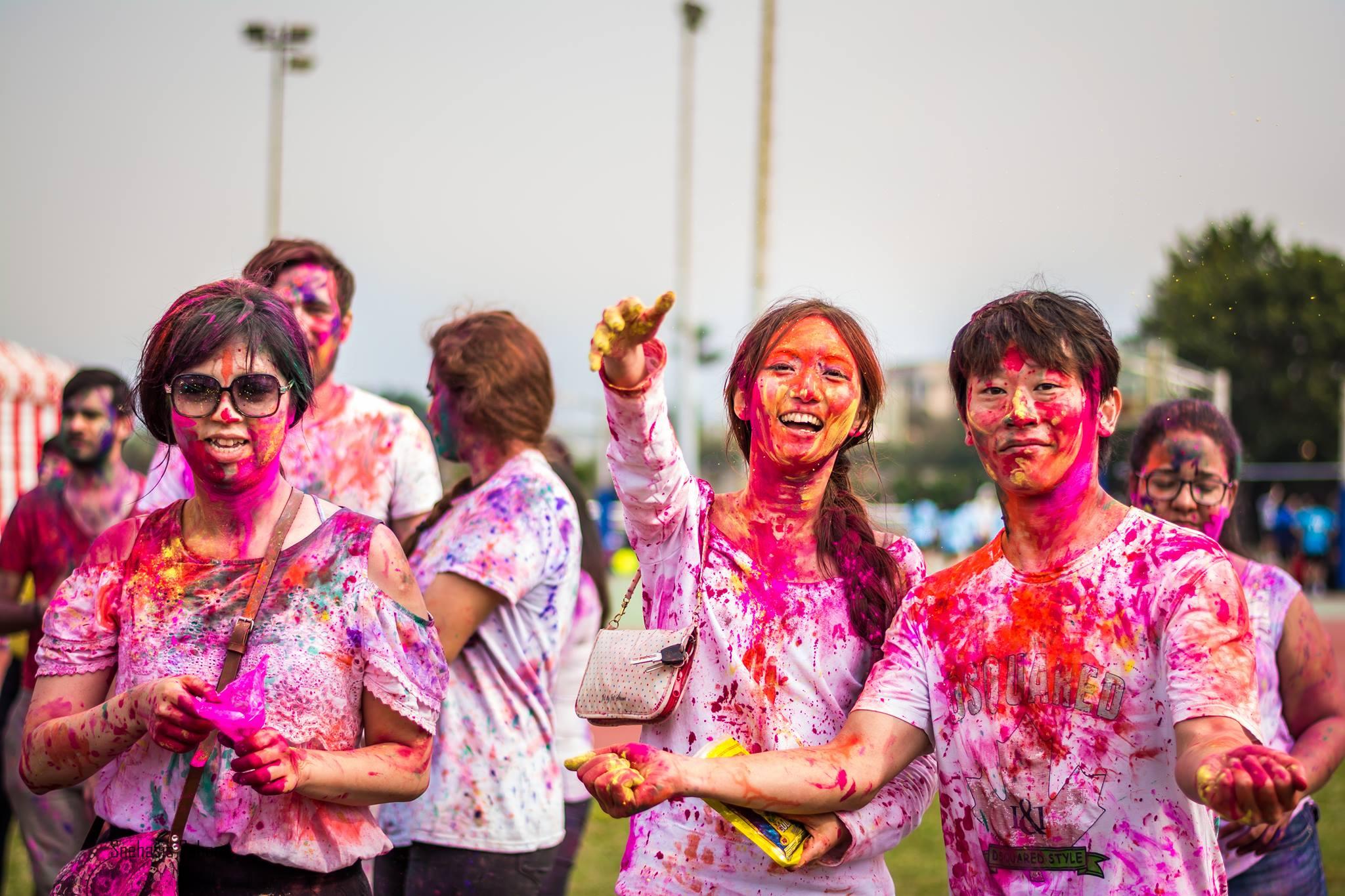 Holi festival revelers covered in colored powder. (Photo by Mayur Srivastava)