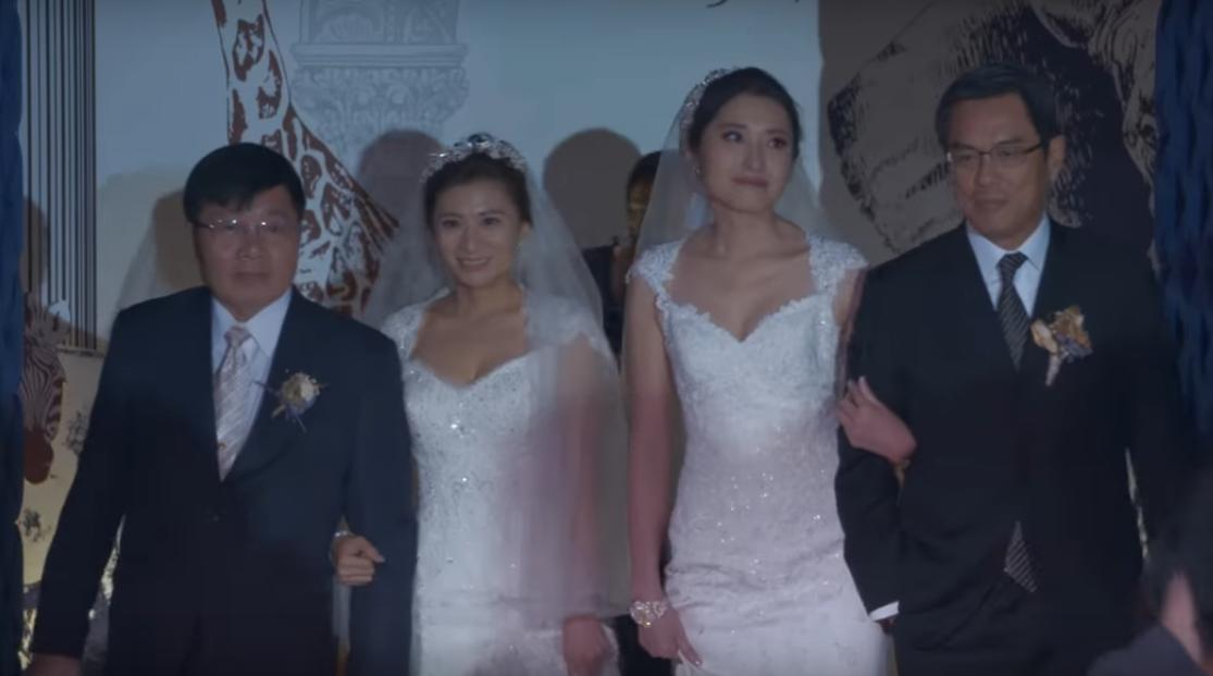 John Li (far right), the CEO of HSBC Taiwan  walks lesbian employee Jennifer Chang (second right) down the aisle. (Screenshot of HSBC Now  video)
