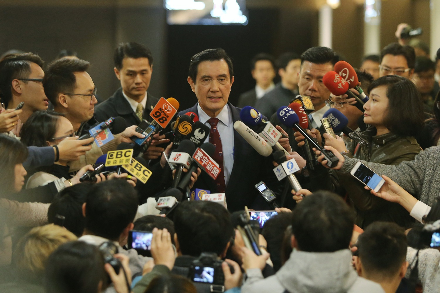 Former President Ma Ying-jeou fielding questions from reporters Mar. 14, after being indicted for leaking state secrets.