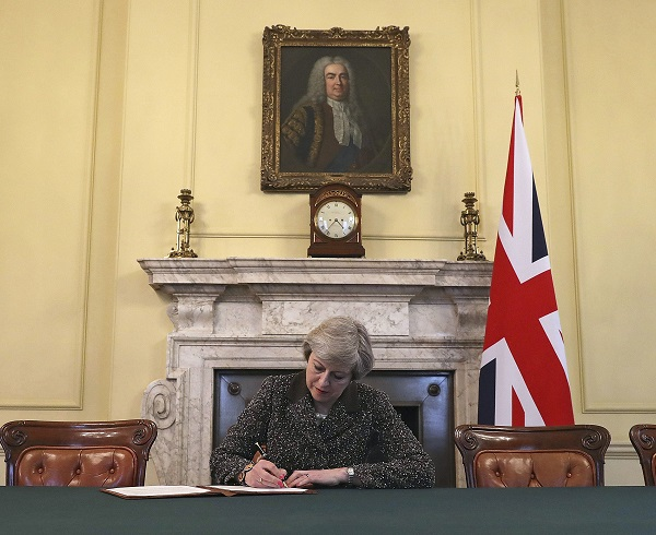 British Prime Minister Theresa May signs Brexit letter on Tuesday invoking Article 50 (Christopher Furlong/AP)