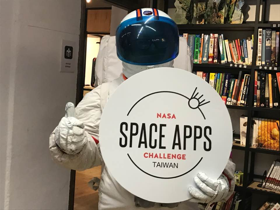 A person dressed as an astronaut promoting NASA Space Apps Challenge in Taiwan.