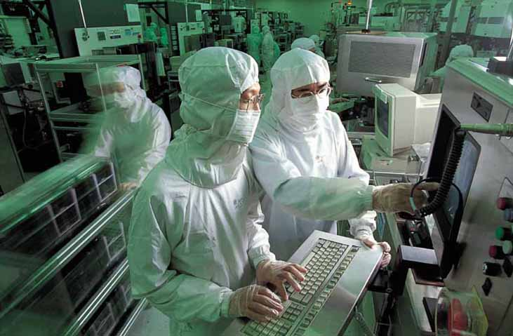 TSMC employees operating  8-inch wafer equipment at a fab in Taiwan. (Photo courtesy of TSMC)
