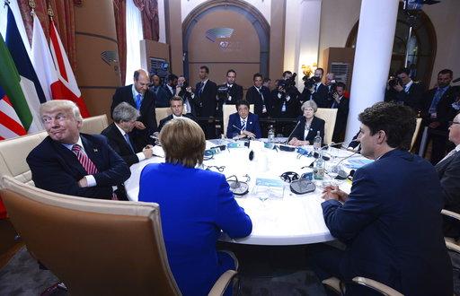 在G7高峰會上,六國盼施壓給川普促其在「巴黎協定」議題上妥協,但峰會結束後,川普仍不改其強硬態度。(圖片來源:AP)