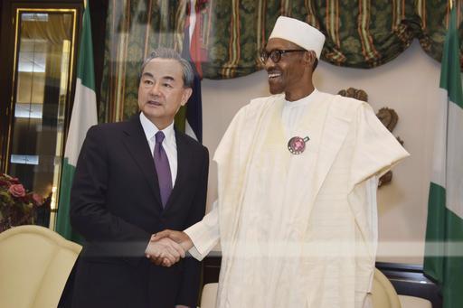 Chinese Foreign Minister Wang Yi (left) visiting Nigerian President Muhammadi Buhari last January.