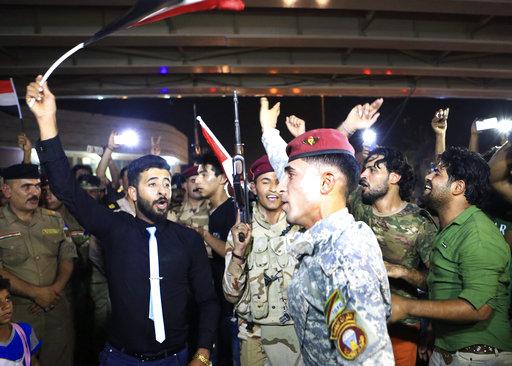 伊拉克軍方9日收復伊斯蘭國(IS)大本營的摩蘇爾市,伊拉克總理阿巴迪發表演說,正式宣布戰勝伊斯蘭國。(圖片來源:AP)