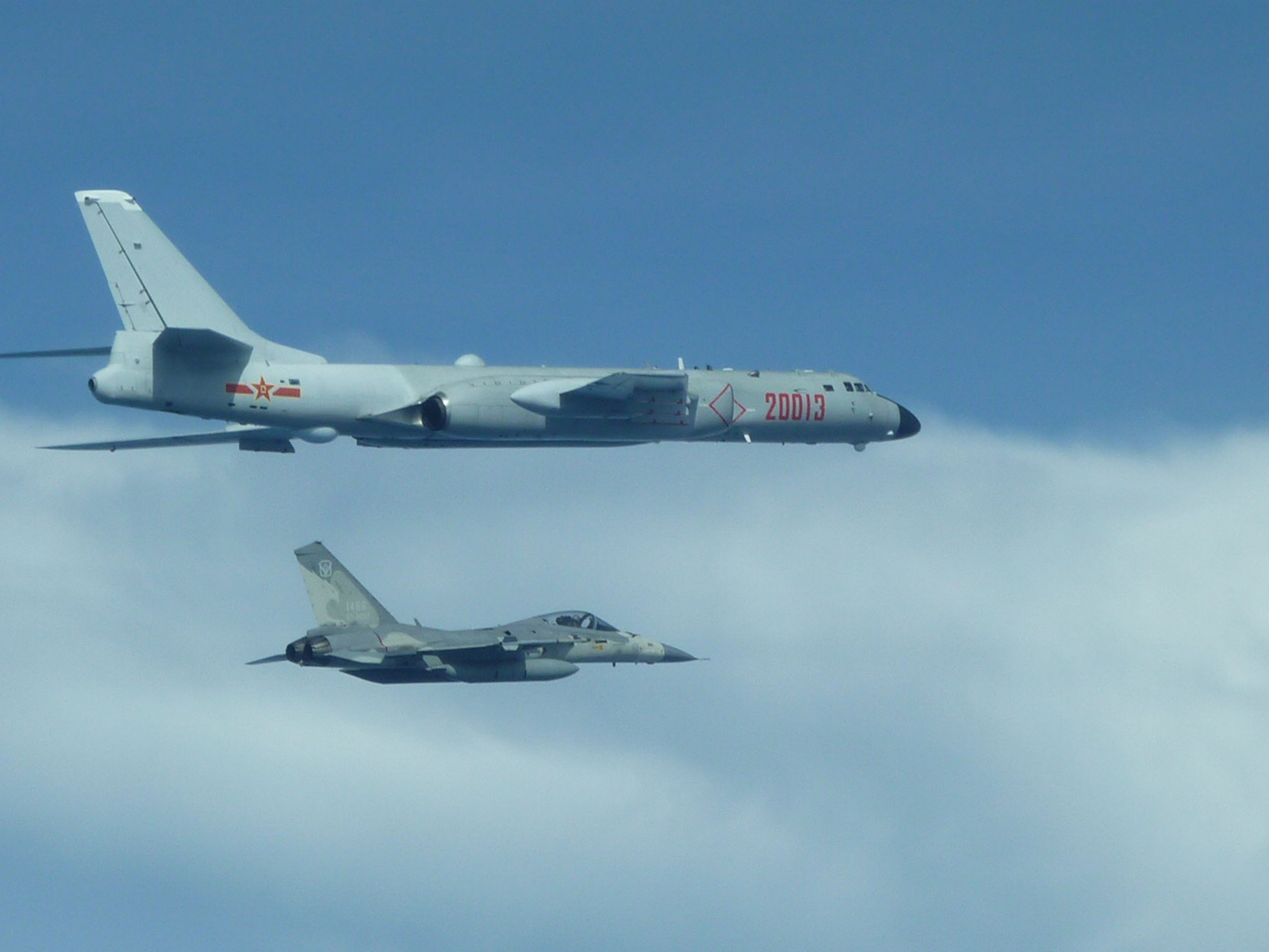 A Chinese H-6K bomber (top) with a Taiwanese IDF. (Photo courtesy of Taiwan MND)