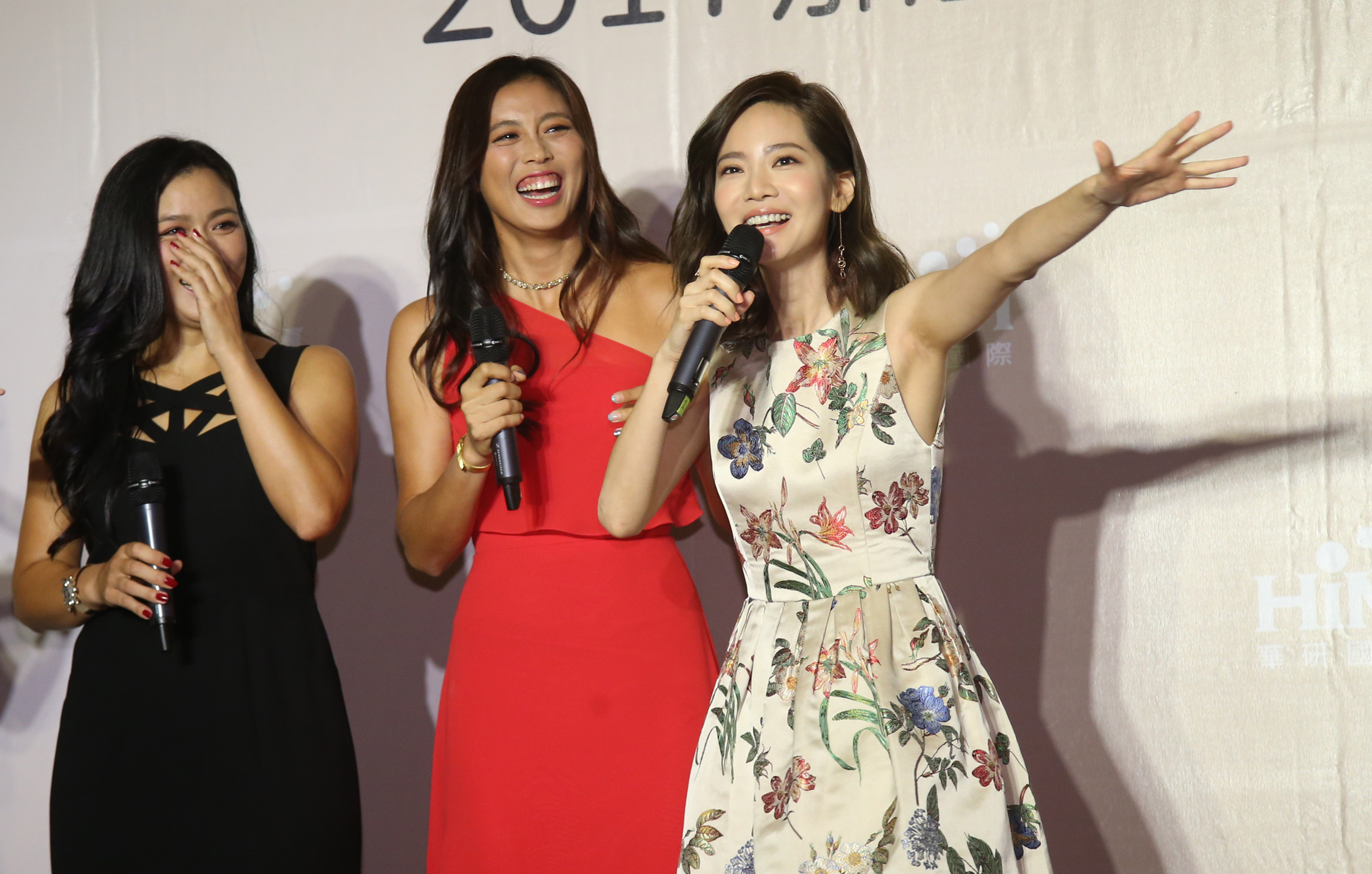 Chan Yung-jan and Chan Hao-ching with host Joanne Tseng (from left to right).