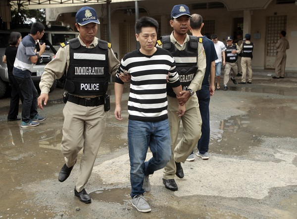 One telephone fraud is arrested by the Cambodian police. (Source: AP)