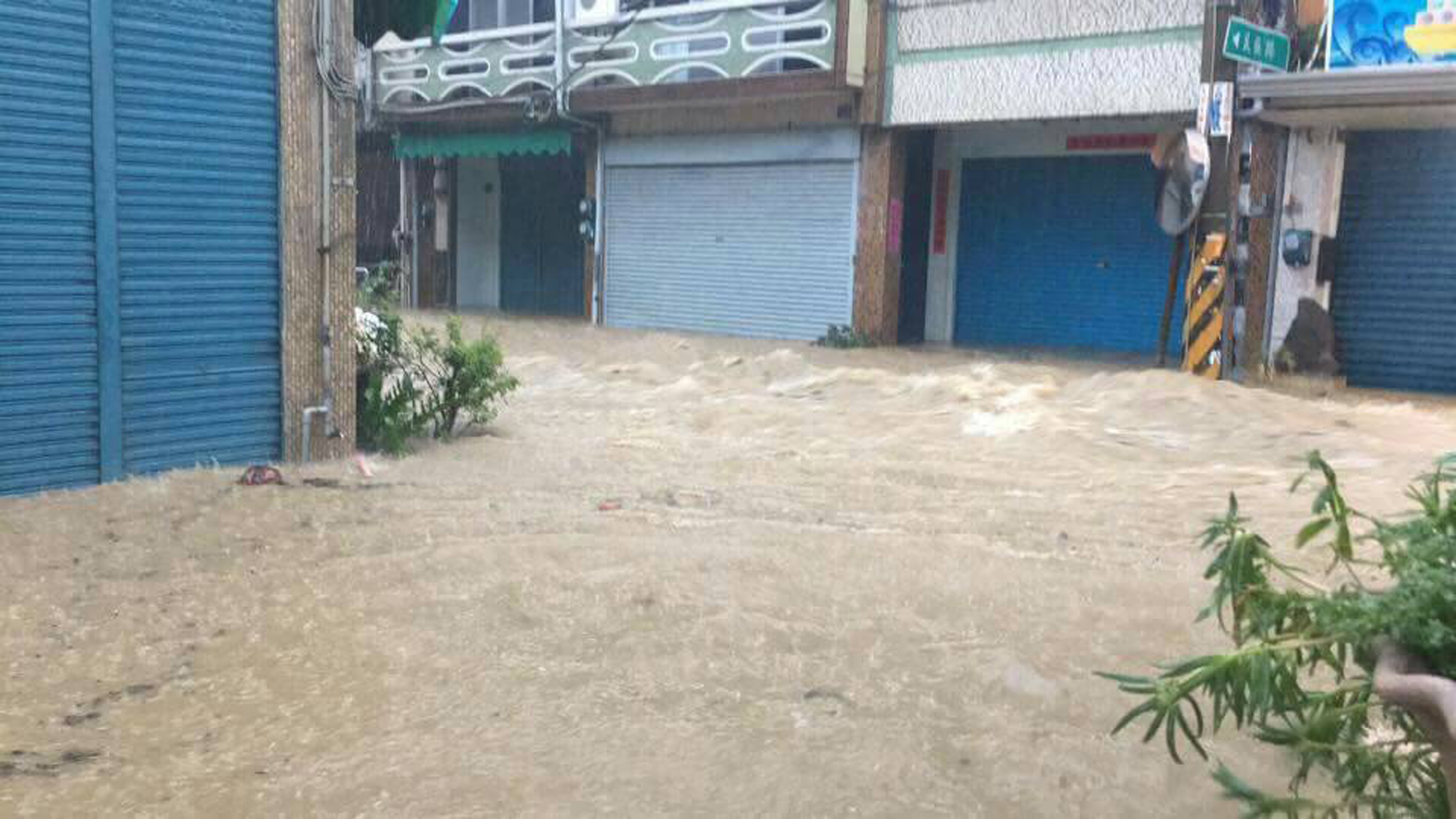 Flooding in Pingtung, one of the areas shutting down Sunday.
