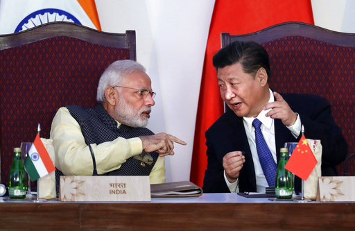 Indian Prime Minister Narendra Modi, left, talks with Chinese President Xi Jinping at a signing ceremony by foreign ministers during the BRICS summit ...
