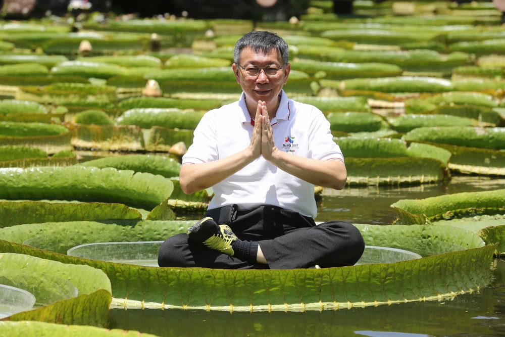 Taipei Mayor Ko Wen-je sitting on giant lilly.