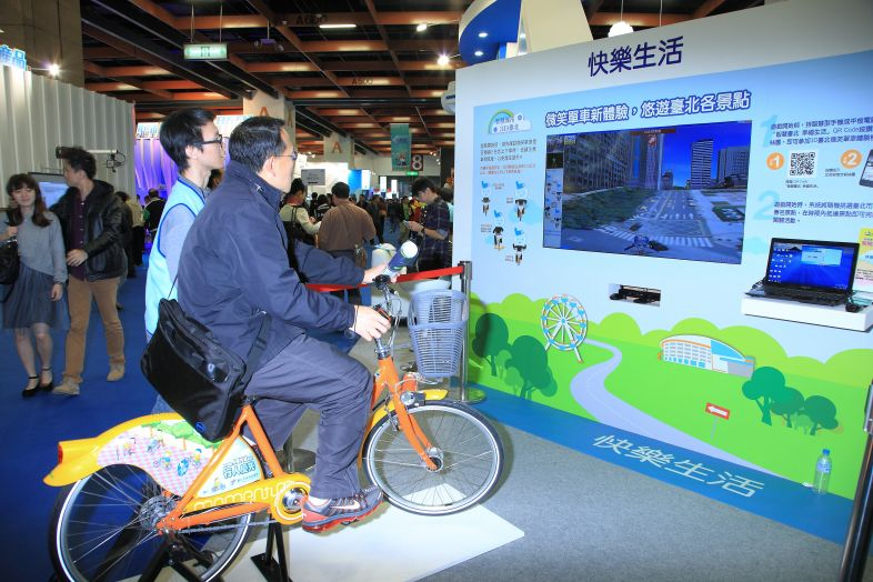 A trade show visitor tries a government-sponsored app enabling tourists to virtually explore the city's attractions, one of the e-services that helped...