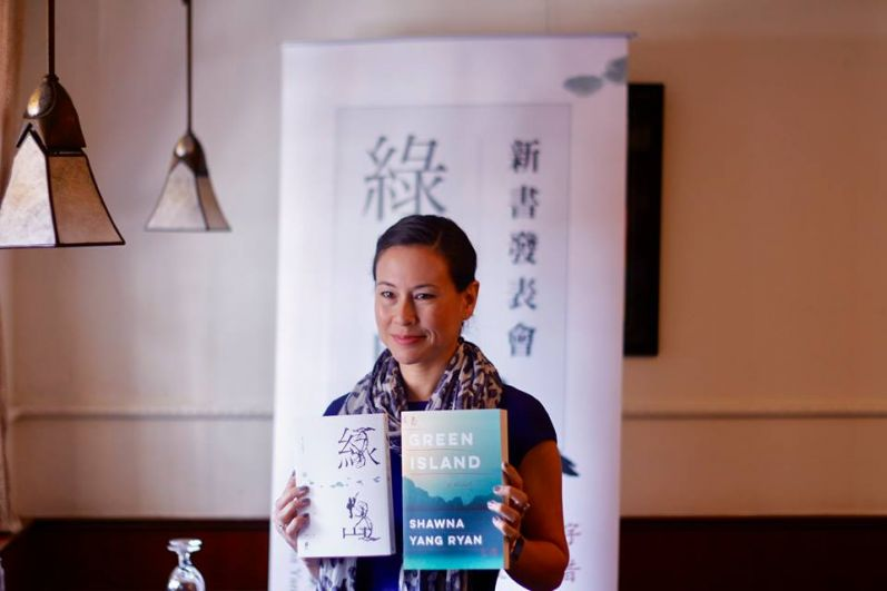 "Taiwan-American author Shawna Yang Ryan poses with English and Mandarin editions of her novel ""Green Island."" (Shawna Yang Ryan's Facebook page)"