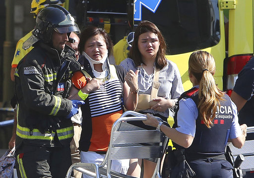 Injured people are treated in Barcelona, Spain, Thursday