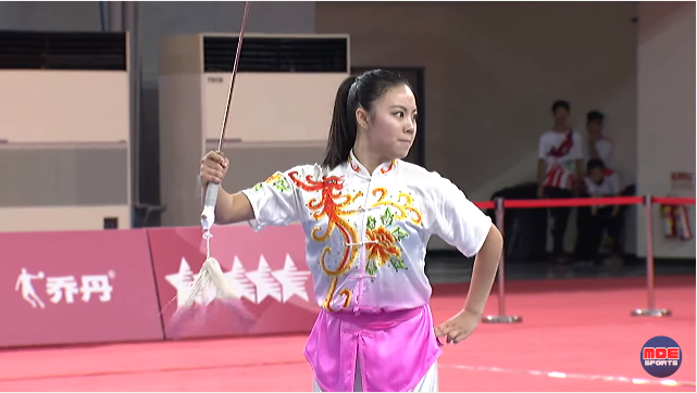Emily Fan competing in wushu straight sword.