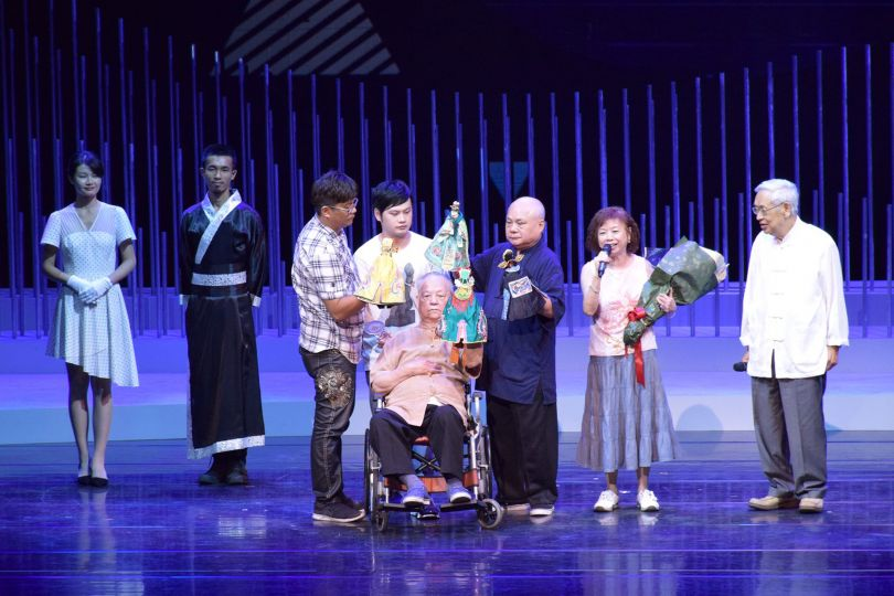 Glove puppetry master Hsu Wang (center) receives a Lifetime Contribution prize at the Golden Melody Awards for Traditional Arts and Music Aug. 26 in T...
