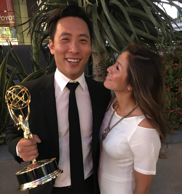 Kelvin Yu (left) holds Emmy with wife Karina (right).