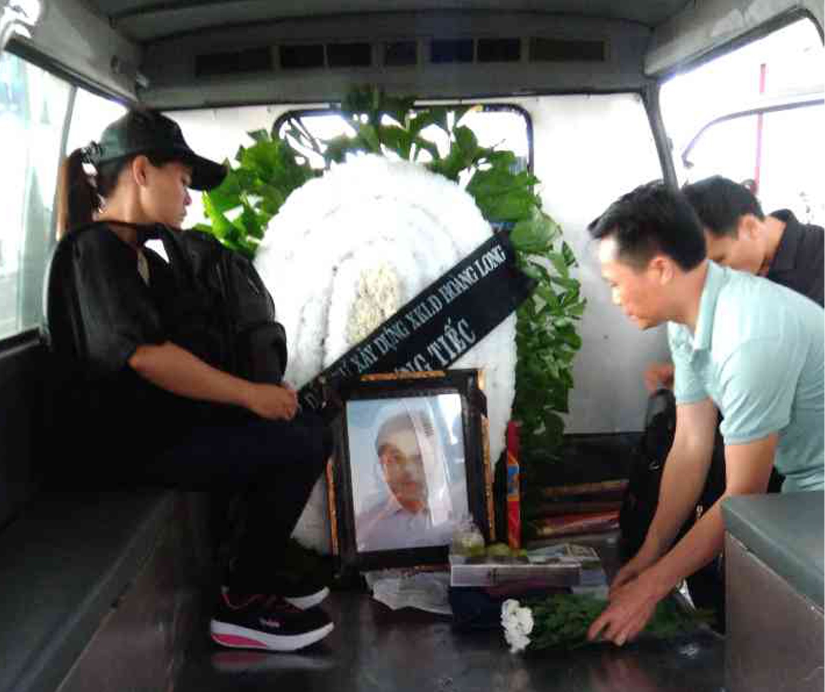 Nguyen Quoc Phi's sister carried his ossuary in the black backpack.