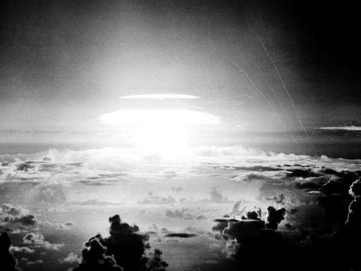Hydrogen bomb lights the Pacific sky a few seconds after the bomb was released over Bikini Atoll in 1956.