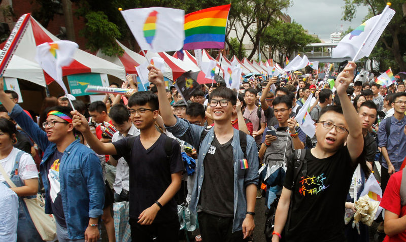 LGBT rights activists calling for progress on same-sex marriage.