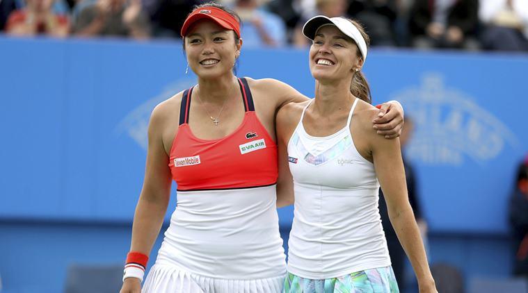 Chan Yung-jan (left) and Martina Hingis.