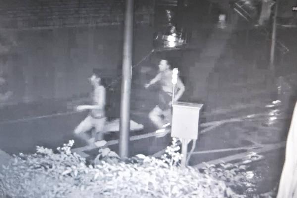 CCTV footage of Hsieh (Lt.) fleeing Chang (Rt.).