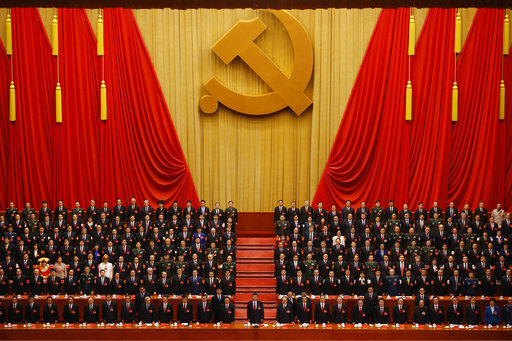 Chinese President Xi Jinping stands with cadres at closing ceremony for 19th Party Congress in Beijing.