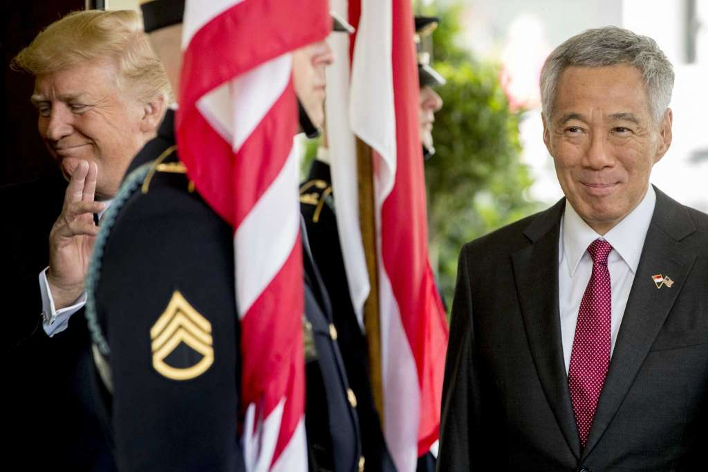 Singapore Prime Minister Lee Hsien Loong (right) welcomed at the White House by President Donald Trump.