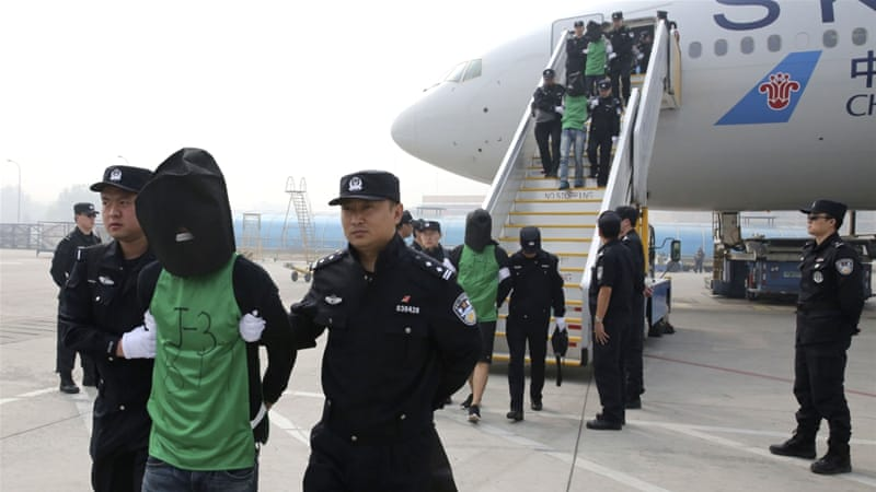 Taiwanese fraud suspects arriving from Kenya in China last year.