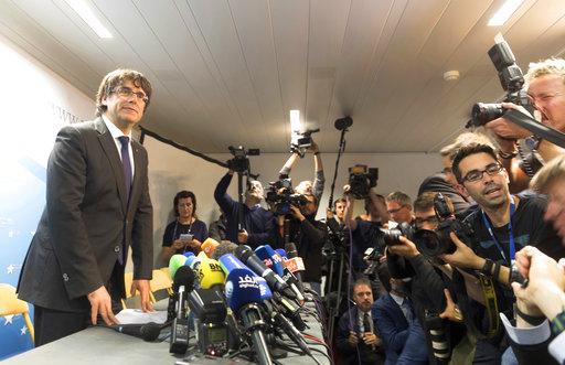 他遭到中央政府罷黜後將暫時待在比利時,但他否認會因可能遭控叛亂罪而尋求庇護。(圖片來源:AP)