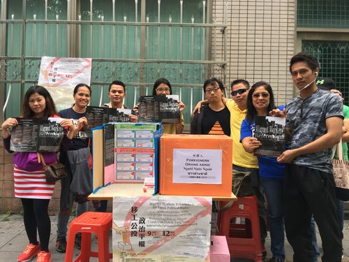 Volunteers and voters at one of the  referendum ballot box near St. Christopher's Church on Chung Shan North Road
