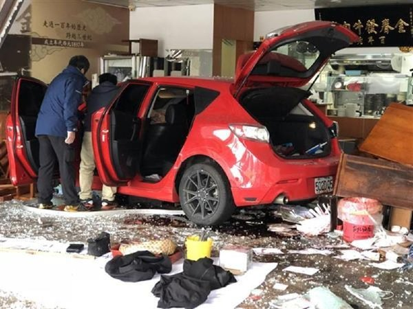 Car smashes into Beef noodle shop.