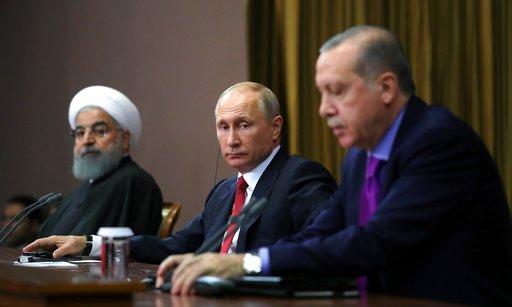 三國領袖於22日在黑海沿岸城市索契達成「索契聲明」,願協助召開會議解決持續七年的敘利亞內戰問題。(圖片來源:AP)