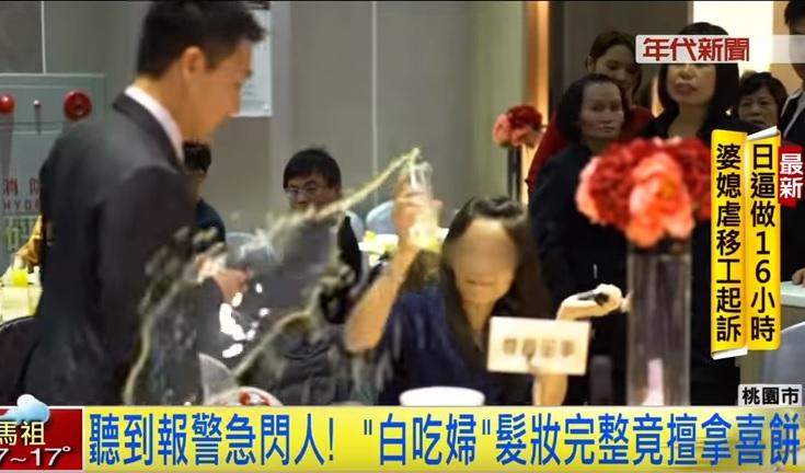 Woman hurling juice at manager. (Screenshot of ERA TV video)