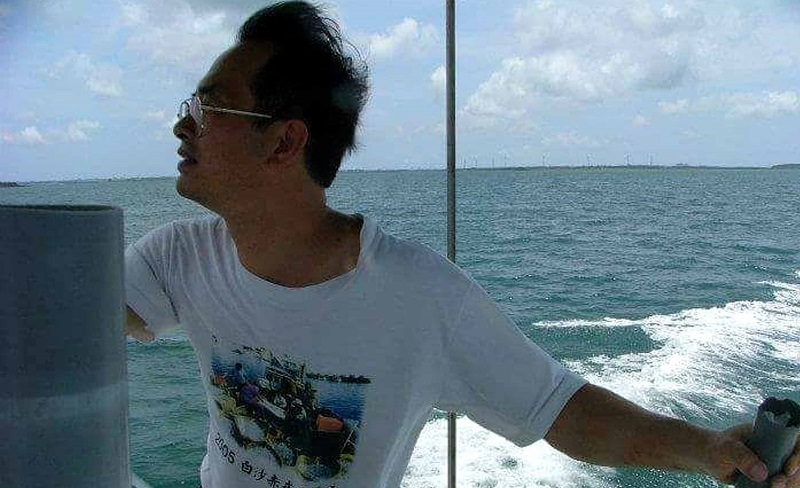 Ho used his own money to buy two boats for sailing to the islands.  (Photo by CNA)