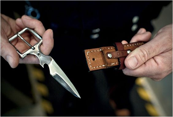 Stock image of belt buckle knife. (Image from Pinterest user Bown Belt Knife)